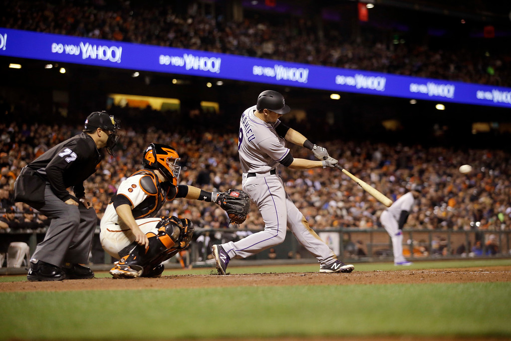 . Colorado Rockies\' DJ LeMahieu drives in a run with a single against the San Francisco Giants during the fifth inning of a baseball game Thursday, May 5, 2016, in San Francisco. (AP Photo/Marcio Jose Sanchez)