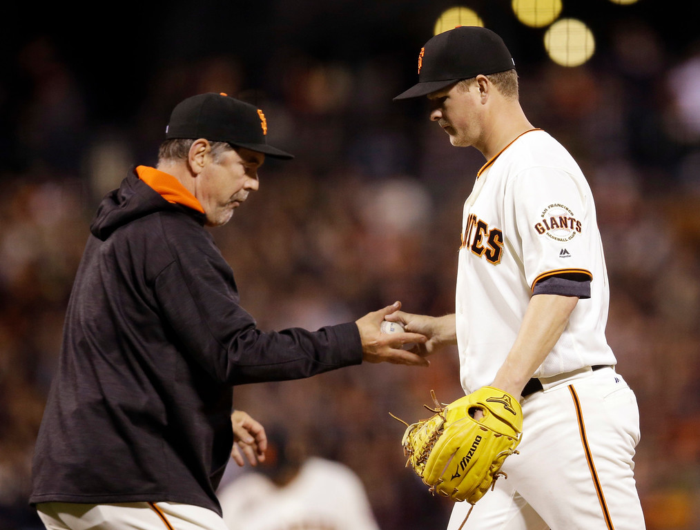 . San Francisco Giants starting pitcher Matt Cain, right, is pulled from the game by manager Bruce Bochy during the fight inning of a baseball game against the Colorado Rockies Thursday, May 5, 2016, in San Francisco. (AP Photo/Marcio Jose Sanchez)