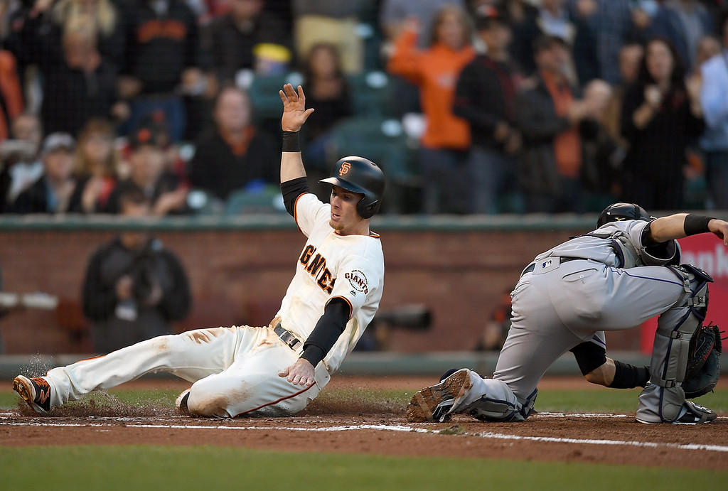 . SAN FRANCISCO, CA - MAY 05:  Matt Duffy #5 of the San Francisco Giants scores against the Colorado Rockies in the bottom of the first inning at AT&T Park on May 5, 2016 in San Francisco, California.  (Photo by Thearon W. Henderson/Getty Images)