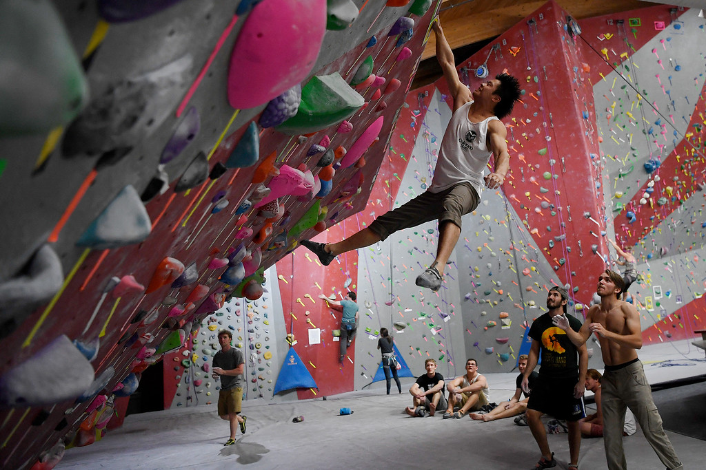. FORT COLLINS, CO - MAY 05: CSU climber Michael Jiang gets to the top of the bouldering wall by way of a dyno on Thursday, May 5, 2016. In April, the Colorado State climbing team won the USA Climbing national title � its second straight win. (Photo by AAron Ontiveroz/The Denver Post)
