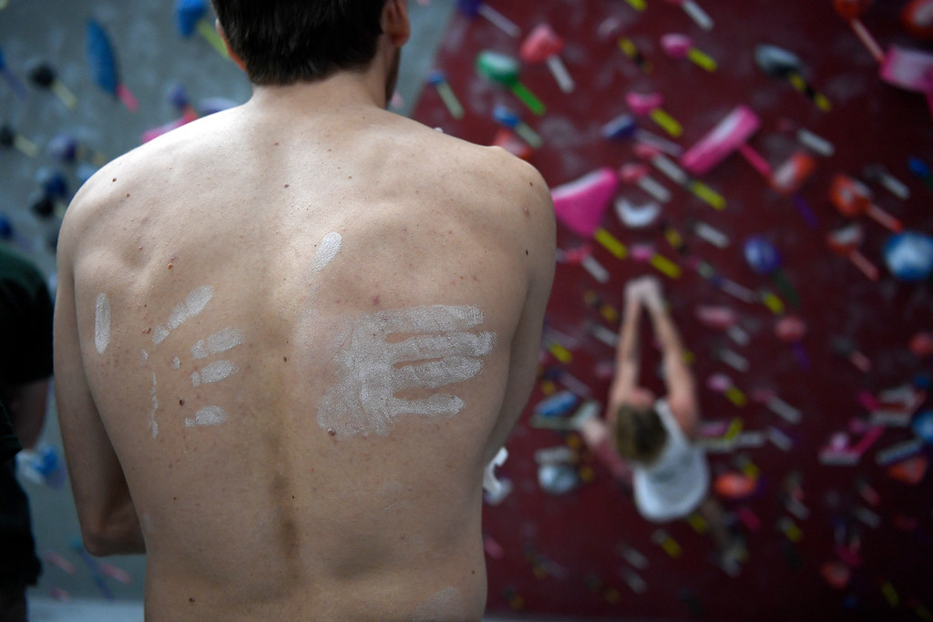 . FORT COLLINS, CO - MAY 05: Dennis Yegienek watches teammates boulder as his back is covered by climbing chalk hand prints on Thursday, May 5, 2016. In April, the Colorado State climbing team won the USA Climbing national title � its second straight win. (Photo by AAron Ontiveroz/The Denver Post)