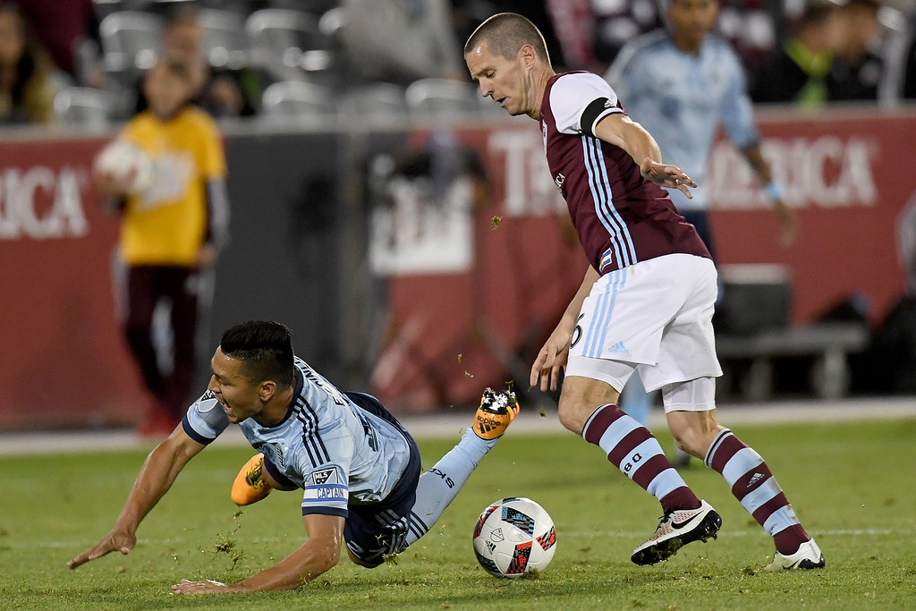 . COMMERCE CITY, CO - MAY 11: Sam Cronin (6) of Colorado Rapids takes Roger Espinoza (27) of Sporting Kansas City down during the second half of the Rapids\' 1-0 win. The Colorado Rapids hosted Sporting Kansas City on Wednesday, May 11, 2016. (Photo by AAron Ontiveroz/The Denver Post)