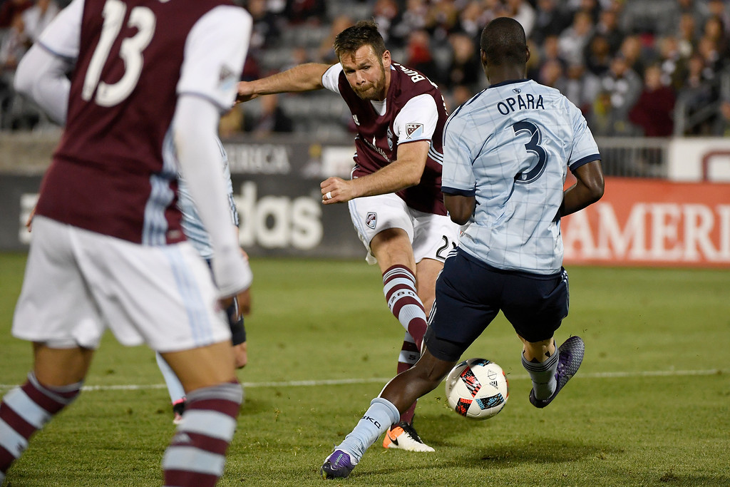 . COMMERCE CITY, CO - MAY 11: Bobby Burling (23) of Colorado Rapids takes a shot as Ike Opara (3) of Sporting Kansas City defends during the second half of the Rapids\' 1-0 win. The Colorado Rapids hosted Sporting Kansas City on Wednesday, May 11, 2016. (Photo by AAron Ontiveroz/The Denver Post)