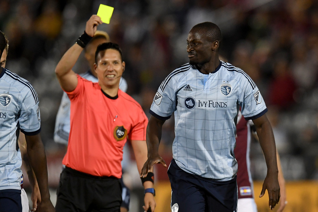 . COMMERCE CITY, CO - MAY 11: Ike Opara (3) of Sporting Kansas City reacts to receiving a yellow card after fouling Kevin Doyle (9) of Colorado Rapids during the second half of the Rapids\' 1-0 win. The Colorado Rapids hosted Sporting Kansas City on Wednesday, May 11, 2016. (Photo by AAron Ontiveroz/The Denver Post)