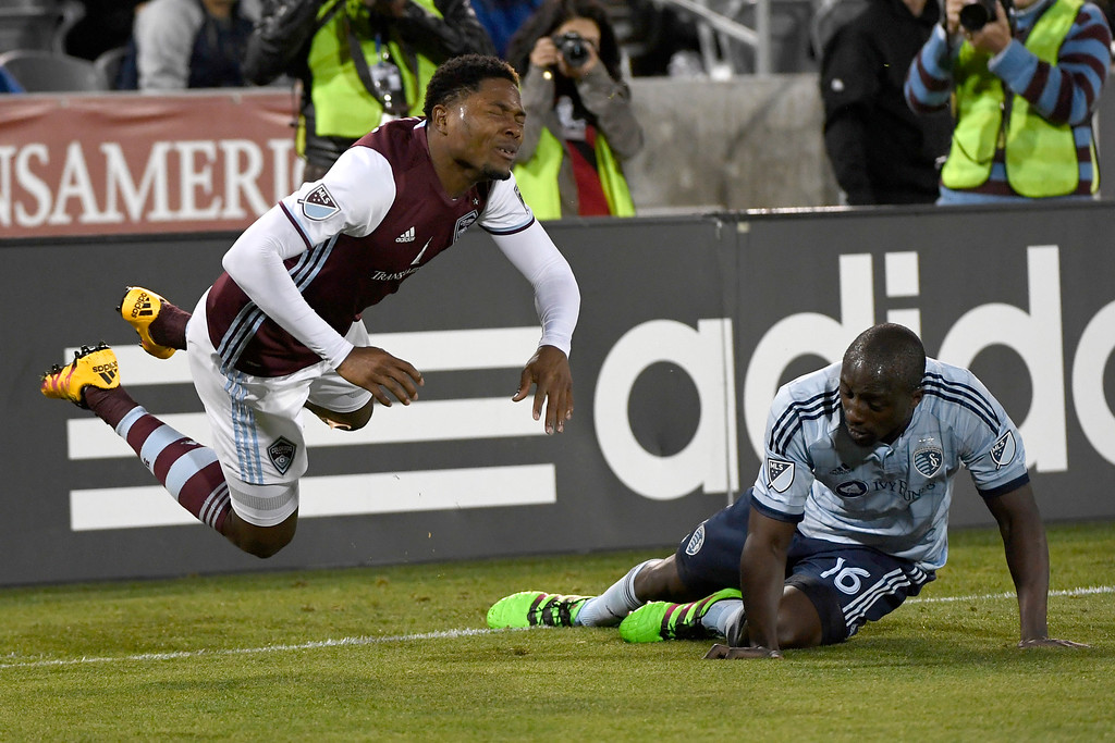 . COMMERCE CITY, CO - MAY 11: Lawrence Olum (16) of Sporting Kansas City fouls Mekeil Williams (5) of Colorado Rapids during the second half of the Rapids\' 1-0 win. The Colorado Rapids hosted Sporting Kansas City on Wednesday, May 11, 2016. (Photo by AAron Ontiveroz/The Denver Post)