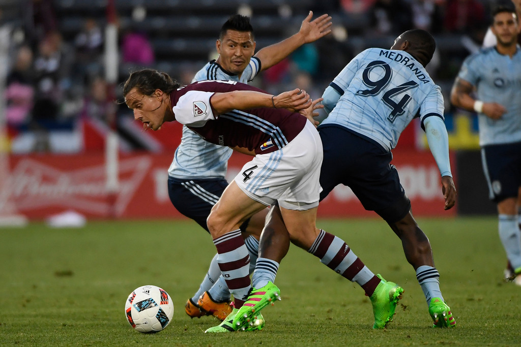 . COMMERCE CITY, CO - MAY 11: Marc Burch (4) of Colorado Rapids battles against Jimmy Medranda (94) of Sporting Kansas City and Roger Espinoza (27) during the first half of action. The Colorado Rapids hosted Sporting Kansas City on Wednesday, May 11, 2016. (Photo by AAron Ontiveroz/The Denver Post)