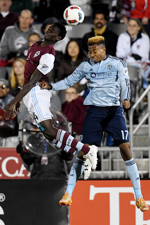 . COMMERCE CITY, CO - MAY 11: Dominique Badji (14) of Colorado Rapids and Saad Abdul-Salaam (17) of Sporting Kansas City vie for the ball during the second half of the Rapids\' 1-0 win. The Colorado Rapids hosted Sporting Kansas City on Wednesday, May 11, 2016. (Photo by AAron Ontiveroz/The Denver Post)