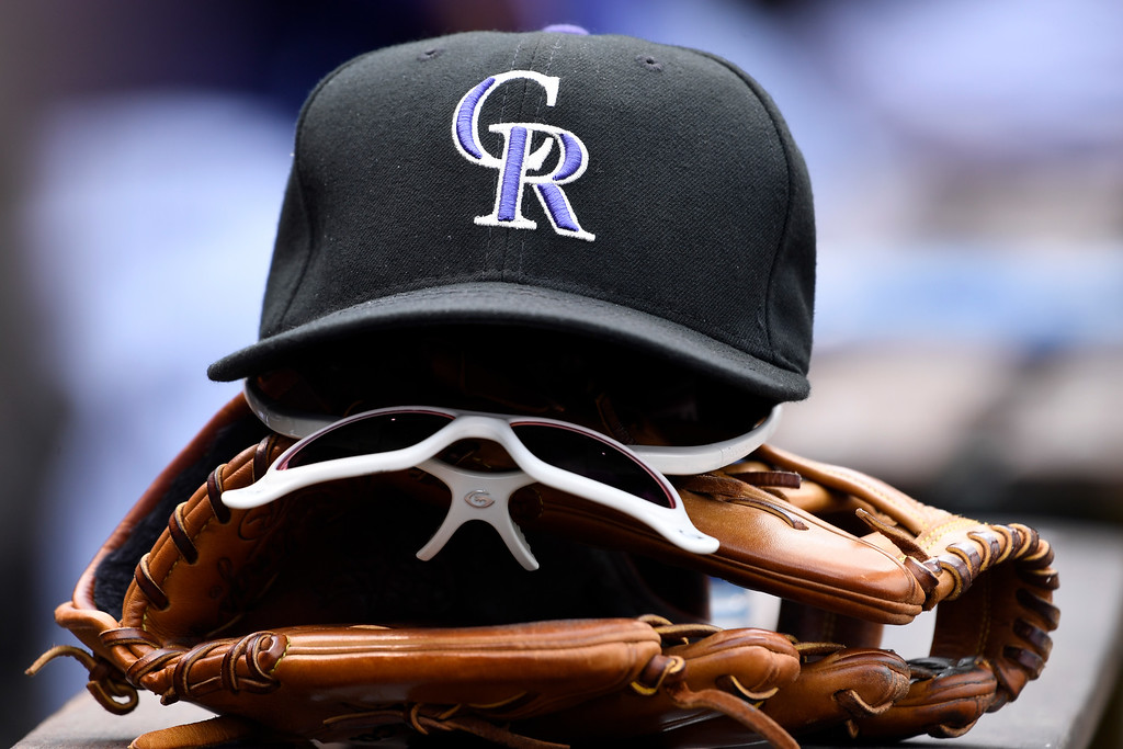 . DENVER, CO - MAY 11: Colorado Rockies hat, glasses and glove in the dugout during their game against the Arizona Diamondbacks May 11, 2016 at Coors Field. (Photo By John Leyba/The Denver Post)