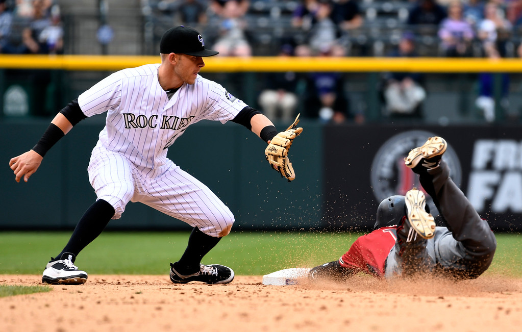 . DENVER, CO - MAY 11: Arizona Diamondbacks shortstop Nick Ahmed (13) slides safely in to second base for a double during the 6th inning as Colorado Rockies shortstop Trevor Story (27) covers the bag May 11, 2016 at Coors Field. (Photo By John Leyba/The Denver Post)