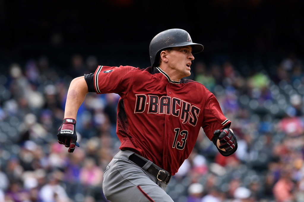 . DENVER, CO - MAY 11: Arizona Diamondbacks shortstop Nick Ahmed (13) sprints down the first base line on his way to second base for a double during the 6th inning May 11, 2016 at Coors Field. (Photo By John Leyba/The Denver Post)