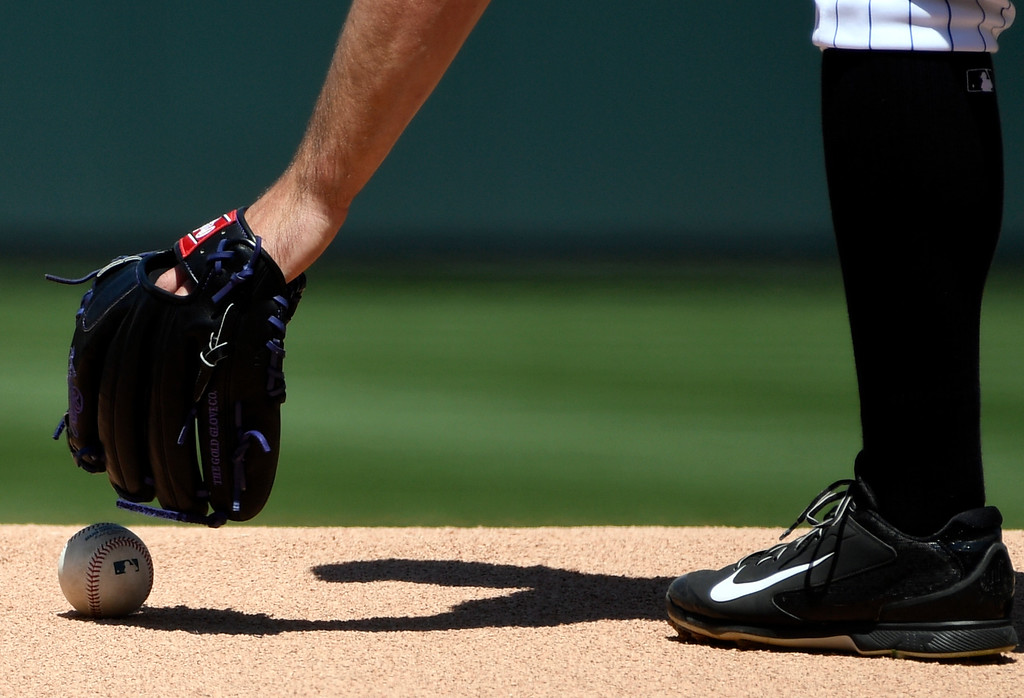. DENVER, CO - MAY 11: Colorado Rockies starting pitcher Chad Bettis (35) picks up the baseball off the mound to start the game against the Arizona Diamondbacks May 11, 2016 at Coors Field. (Photo By John Leyba/The Denver Post)