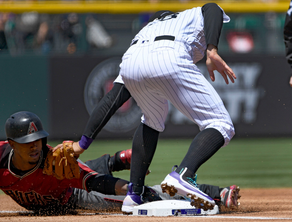 . DENVER, CO - MAY 11: Arizona Diamondbacks second baseman Jean Segura (2) is tagged out by Colorado Rockies third baseman Nolan Arenado (28) on an attempted steal during the first inning May 11, 2016 at Coors Field. Segura was thrown out by Rockies catcher Dustin Garneau. (Photo By John Leyba/The Denver Post)