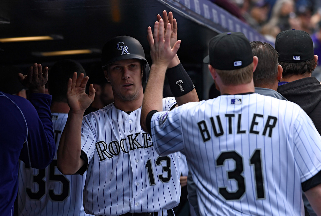 . DENVER, CO - MAY 11: Colorado Rockies catcher Dustin Garneau (13) high fives Colorado Rockies relief pitcher Eddie Butler (31) after scoring on a Colorado Rockies center fielder Charlie Blackmon (19) single in the 4th inning against the Arizona Diamondbacks May 11, 2016 at Coors Field. (Photo By John Leyba/The Denver Post)