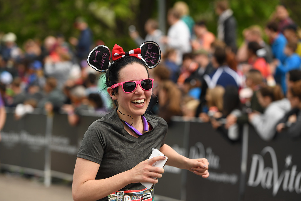 . DENVER, CO - MAY 15: Runner Jessica Brown, of Brighton, smiles as she crosses the finish line of the Colfax Half Marathon during the 11th annual Colfax Half Marathon on May 15, 2016 in Denver, Colorado.  Thousands of runners took part in the annual springtime race which included a marathon, a marathon relay,  a half marathon and the urban 10 miler.  (Photo by Helen H. Richardson/The Denver Post)
