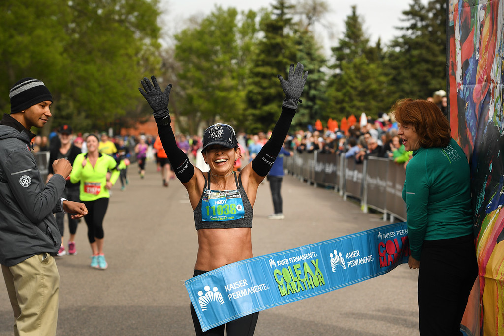 . DENVER, CO - MAY 15: Runner Heidy Lozano, of Boulder, is exuberant as she wins the women\'s race of the Colfax Marathon with a time of 3:10:41 during the 11th annual Colfax Half Marathon on May 15, 2016 in Denver, Colorado.  Lozano is 53 years old and this is the first marathon she has ever won. Thousands of runners took part in the annual springtime race which included a marathon, a marathon relay,  a half marathon and the urban 10 miler.  (Photo by Helen H. Richardson/The Denver Post)