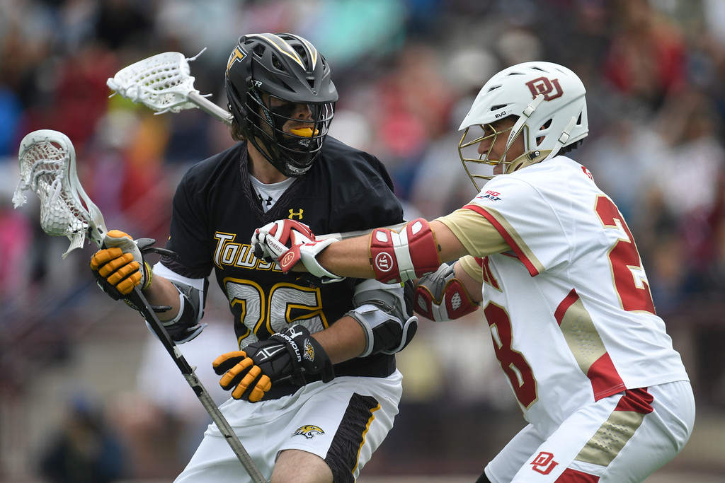 . DENVER, CO - MAY 15:  Dylan Johnson (28) of the Denver defends  Joe Seider (26) of the Towson during the first half. University of Denver hosted Towson University in an NCAA tournament game on Sunday, May 15, 2016. (Photo by AAron Ontiveroz/The Denver Post)