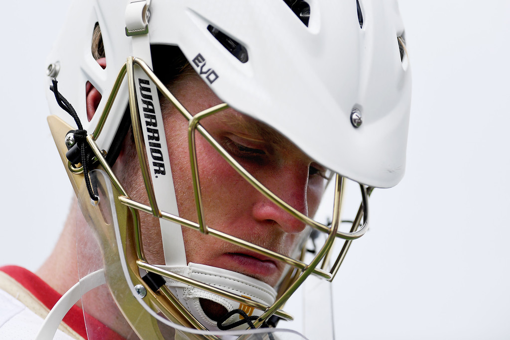 . DENVER, CO - MAY 15:  Alex Ready (16) of the Denver walks off the field after the fourth quarter of Towson\'s 10-9 win. University of Denver hosted Towson University in an NCAA tournament game on Sunday, May 15, 2016. (Photo by AAron Ontiveroz/The Denver Post)