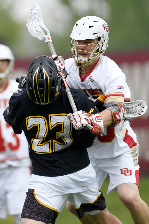 . DENVER, CO - MAY 15:  Joe Bano (35) of the Denver lights up  Tyler Young (23) of the Towson during the first half. University of Denver hosted Towson University in an NCAA tournament game on Sunday, May 15, 2016. (Photo by AAron Ontiveroz/The Denver Post)