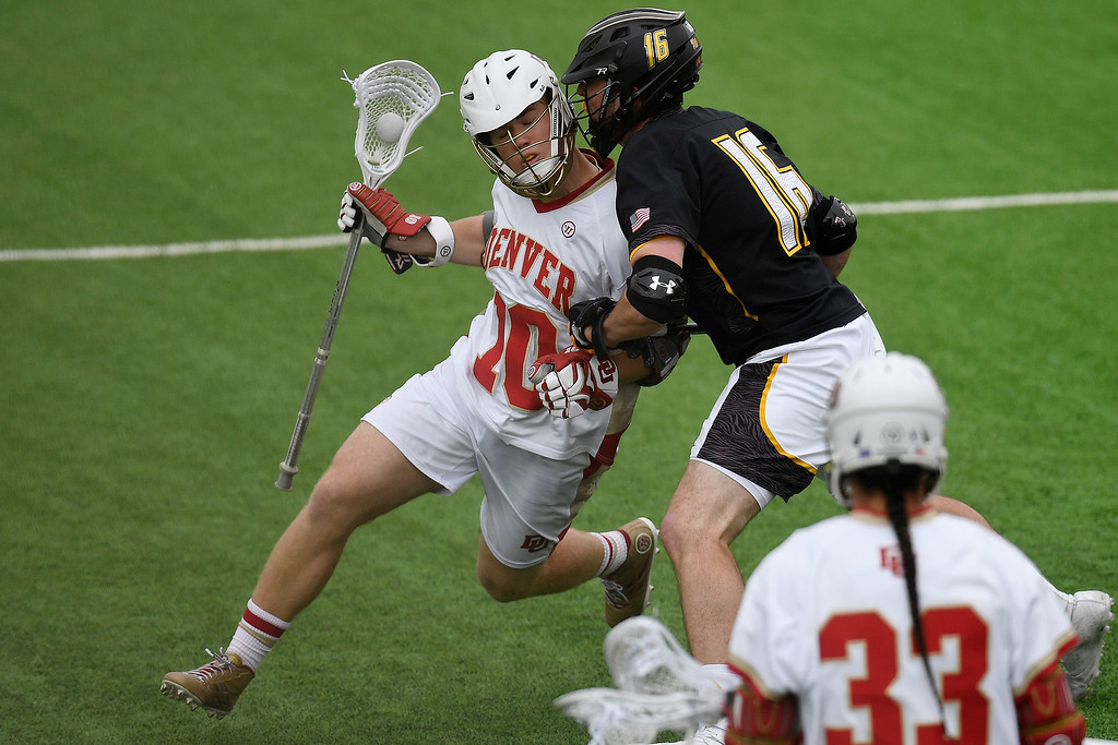. DENVER, CO - MAY 15:  Jack Adams (16) of the Towson gets physical with  Colton Jackson (10) of the Denver during the third quarter. University of Denver hosted Towson University in an NCAA tournament game on Sunday, May 15, 2016. (Photo by AAron Ontiveroz/The Denver Post)