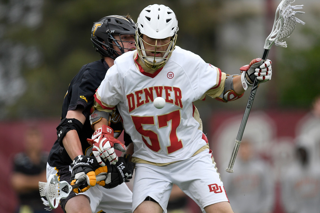 . DENVER, CO - MAY 15:  Zach Goodrich (14) of the Towson forces the ball out of the control of  Colin Woolford (57) of the Denver during the first half. University of Denver hosted Towson University in an NCAA tournament game on Sunday, May 15, 2016. (Photo by AAron Ontiveroz/The Denver Post)