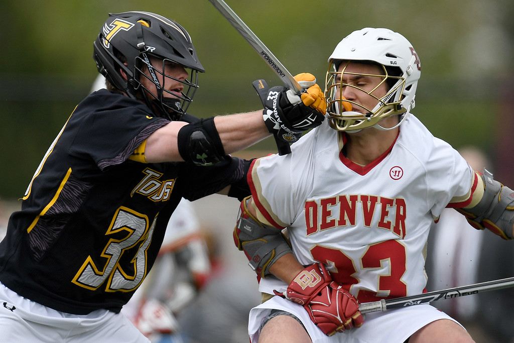 . DENVER, CO - MAY 15:  Tyler Mayes (33) of the Towson checks  Zach Miller (33) of the Denver during the fourth quarter of Towson\'s 10-9 win. University of Denver hosted Towson University in an NCAA tournament game on Sunday, May 15, 2016. (Photo by AAron Ontiveroz/The Denver Post)