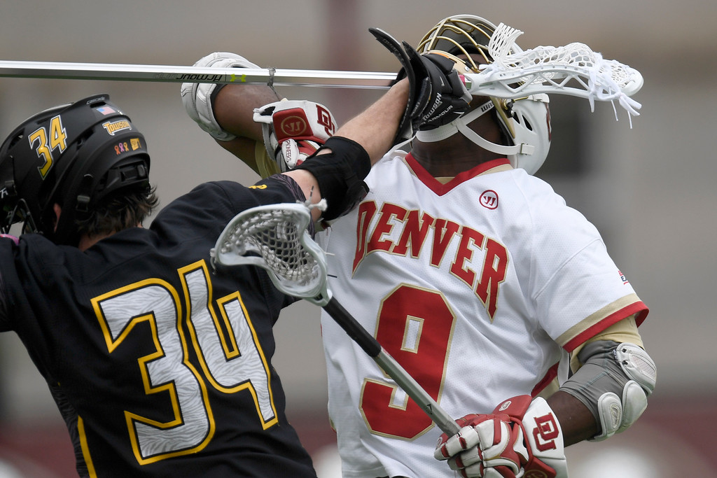 . DENVER, CO - MAY 15:  Pat Conroy (34) of the Towson gets under the chin of  Trevor Baptiste (9) of the Denver after a physical face off during the first half. University of Denver hosted Towson University in an NCAA tournament game on Sunday, May 15, 2016. (Photo by AAron Ontiveroz/The Denver Post)