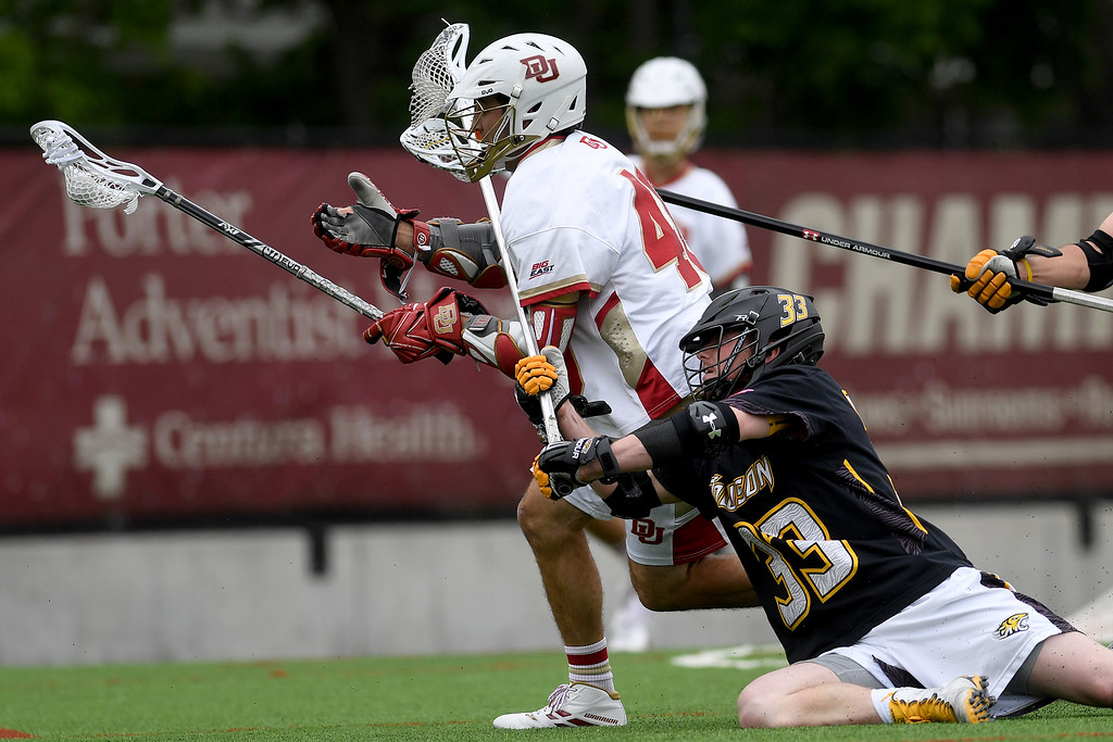 . DENVER, CO - MAY 15:  Tyler Mayes (33) of the Towson hangs on  Connor Cannizzaro (40) of the Denver during the first half. University of Denver hosted Towson University in an NCAA tournament game on Sunday, May 15, 2016. (Photo by AAron Ontiveroz/The Denver Post)