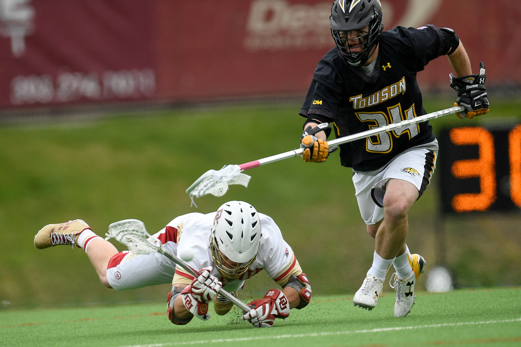 . DENVER, CO - MAY 15:  Zach Runberg (25) of the Denver goes to the turf as he and  Pat Conroy (34) of the Towson vie for the ball during the first half. University of Denver hosted Towson University in an NCAA tournament game on Sunday, May 15, 2016. (Photo by AAron Ontiveroz/The Denver Post)