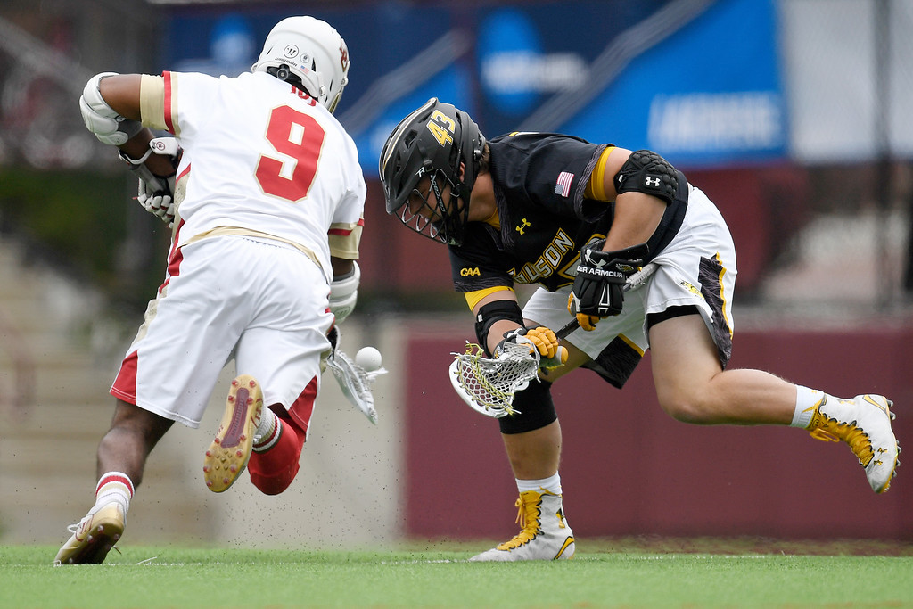 . DENVER, CO - MAY 15:  Trevor Baptiste (9) of the Denver and  Steven Stillwell (43) of the Towson face-off during the first half. University of Denver hosted Towson University in an NCAA tournament game on Sunday, May 15, 2016. (Photo by AAron Ontiveroz/The Denver Post)