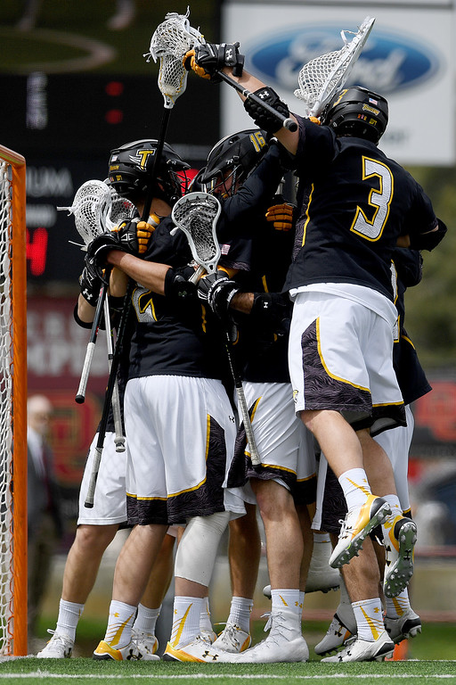 . DENVER, CO - MAY 15: The Towson team celebrates after the fourth quarter of their 10-9 win over Denver. University of Denver hosted Towson University in an NCAA tournament game on Sunday, May 15, 2016. (Photo by AAron Ontiveroz/The Denver Post)