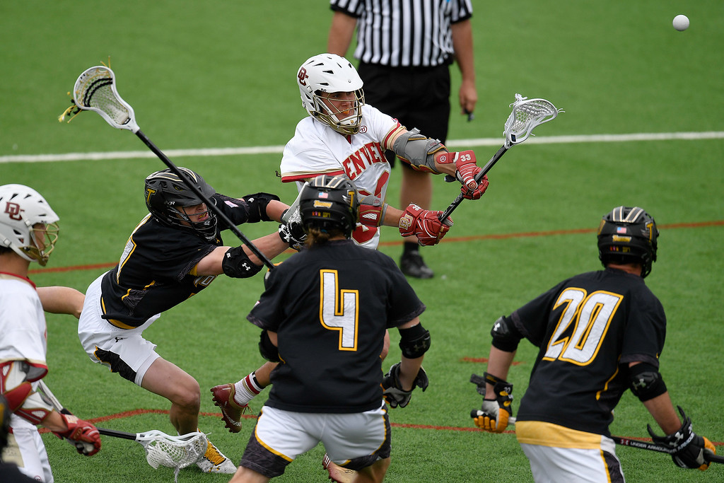 . DENVER, CO - MAY 15:  Zach Miller (33) of the Denver cuts up the Towson defense to score a goal during the third quarter. University of Denver hosted Towson University in an NCAA tournament game on Sunday, May 15, 2016. (Photo by AAron Ontiveroz/The Denver Post)
