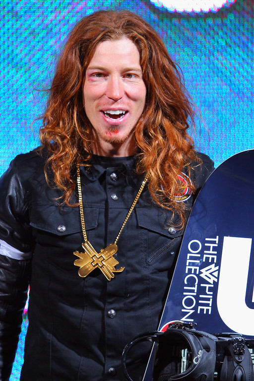 . Shaun White takes the podium for the goal medal in the men\'s snowboard superpipe final during Winter X Games 2012 at Buttermilk Mountain on January 29, 2012 in Aspen, Colorado. White earned his fifth consecutive gold medal in the event and scored a perfect 100 points on his final run.  (Photo by Doug Pensinger/Getty Images)