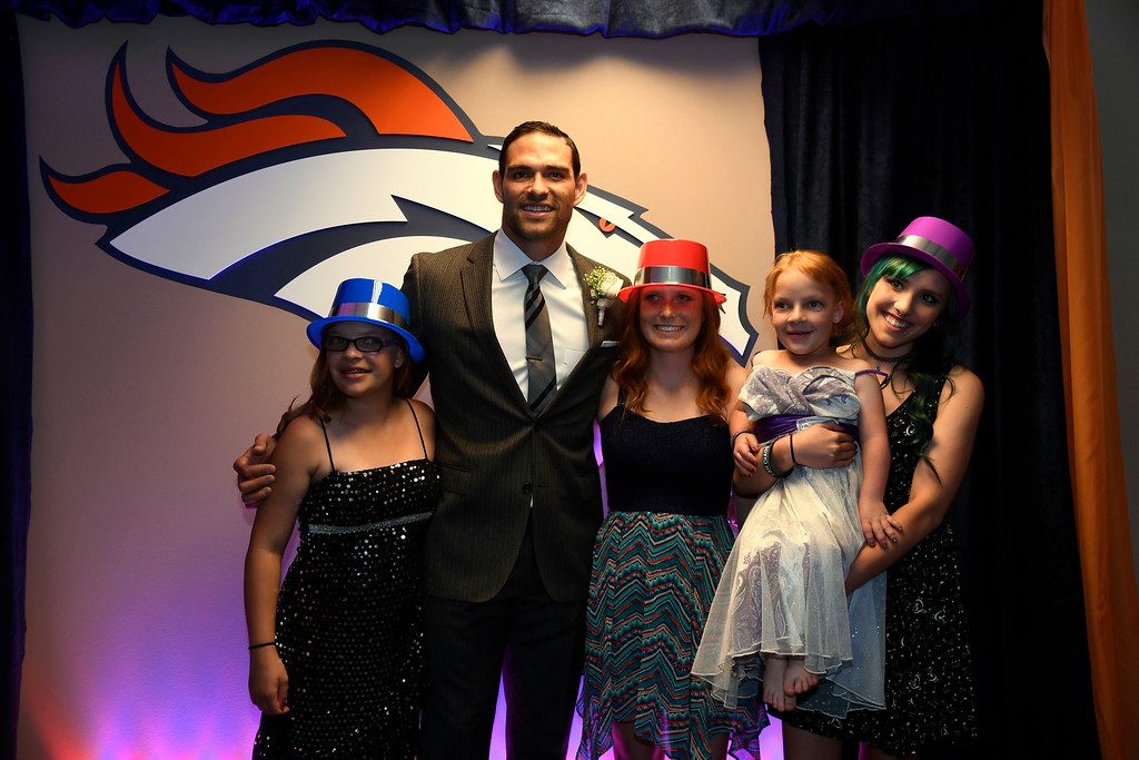 . Denver Broncos quarterback Mark Sanchez poses for a photo during a Night of Champions prom. Teens got their makeup, hair and nails done before prom night May 13, 2016 at Sports Authority Field at Mile High. Some of the teens missed their own prom due to illness and just couldn\'t attend. Childrens Hospital hosted the Night of Champions gala. (Photo By John Leyba/The Denver Post)