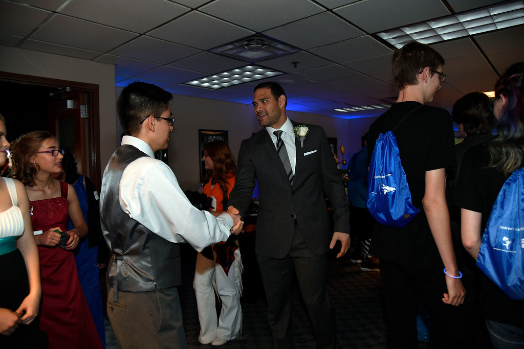 . Denver Broncos quarterback Mark Sanchez greets the prom attendees during a Night of Champions prom. Teens got their makeup, hair and nails done before prom night May 13, 2016 at Sports Authority Field at Mile High. Some of the teens missed their own prom due to illness and just couldn\'t attend. Childrens Hospital hosted the Night of Champions gala. (Photo By John Leyba/The Denver Post)