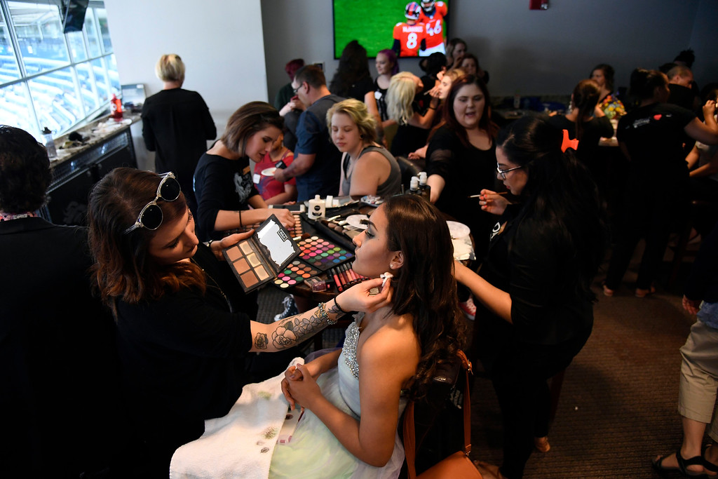 . Teens get their makeup, hair and nails done before prom night May 13, 2016 at Sports Authority Field at Mile High. The teen patients had a treat as they got to meet with Denver Broncos quarterback Mark Sanchez who was on hand to greet them. Some of the teens missed their own prom due to illness and just couldn\'t attend. Childrens Hospital hosted the Night of Champions gala. (Photo By John Leyba/The Denver Post)