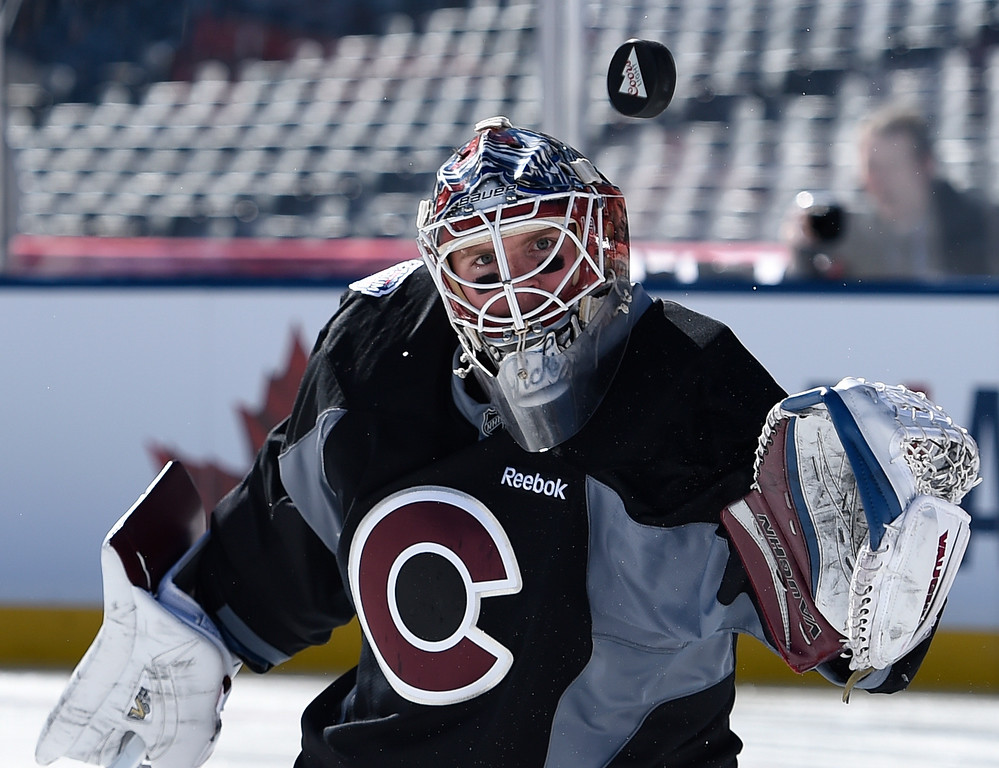 . Colorado Avalanche goalie Calvin Pickard (31) makes a save during practice February 26, 2016 at Coors Field. (Photo By John Leyba/The Denver Post)