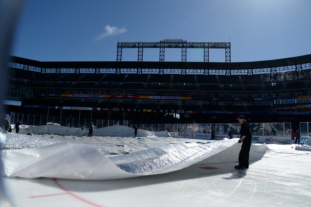 . The ice crew covers the ice after the Colorado Avalanche practice February 26, 2016 at Coors Field. The ice was melting under the hot sun as temperatures reach 60. (Photo By John Leyba/The Denver Post)