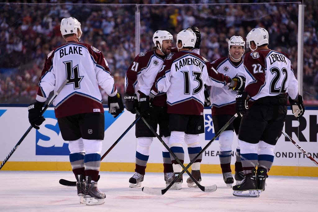 . DENVER, CO - FEBRUARY 26: Colorado Avalanche Peter Forsberg (21) celebrates a goal by against the Colorado Avalanche Valeri Kamensky (13) against the Detroit Red Wings in the first period February 26, 2016 at Coors Field. (Photo By John Leyba/The Denver Post)