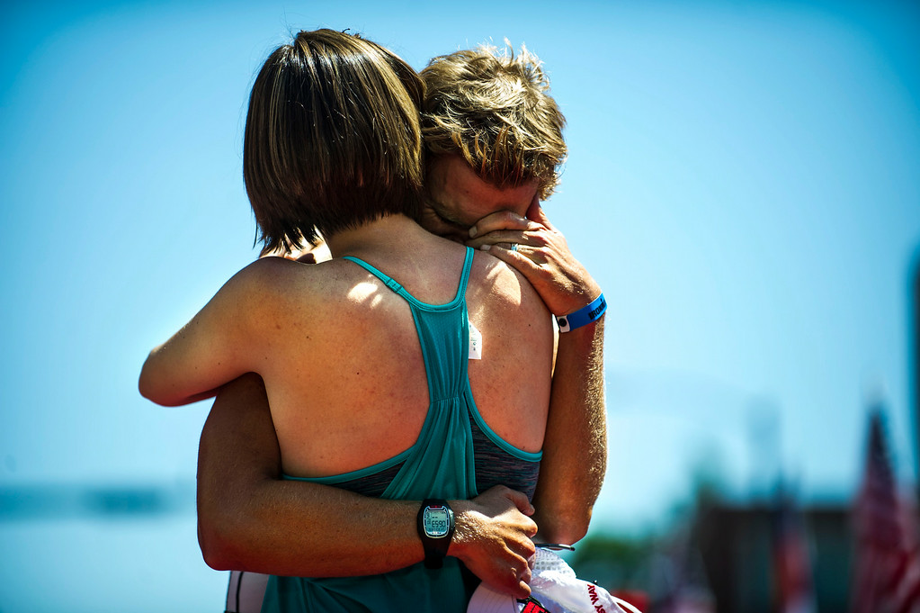 . Justin Daerr, of Boulder, embraces with his wife, Brooke Daerr, after finishing first in the Boulder Ironman on Sunday, August 03, 2014 in Boulder, Colorado.  The first time a full race has been held in Boulder, the Ironman Triathlon features a 2.4 mile swim starting at the Boulder Reservoir followed by a 112 mile bike ride finished off with a 26.2 mile run along the Boulder Creek Trail.  (Photo by Kent Nishimura/The Denver Post)