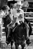 """SEP 1 1988, SEP 2 1988<br /> <br /> Sue Kapushion, Grand Junction, sits with daughter Shanna, 20 months,<br /> waiting to ride in the Snaffle Bit Working Cow Horse competiton on 3 yr old<br /> """"Miss Swift Cloud"""" while chatting with Judy Albers, C.S., who owns the horse,<br /> <br /> Credit: The Denver Post"""