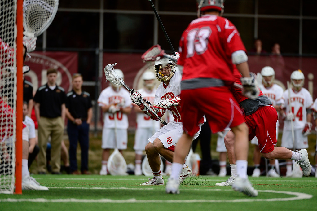 . Denver Connor Cannizzaro (40) looks to take a shot on goal during the second quarter at the University of Denver on February 27, 2016 in Denver, Colorado. Denver drafted Sacred Heart 18-7.  (Photo by Brent Lewis/The Denver Post)