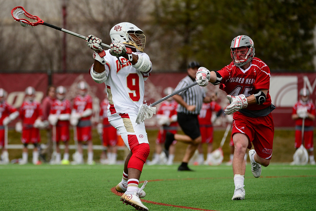 . Denver Trevor Baptiste (9) takes a shot on goal after winning the face off during the first quarter at the University of Denver on February 27, 2016 in Denver, Colorado. Denver drafted Sacred Heart 18-7.  (Photo by Brent Lewis/The Denver Post)