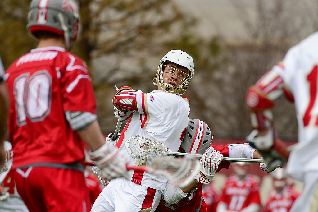 . Denver Nate Marano (23) pulls back to take a shot on goal during the first quarter at the University of Denver on February 27, 2016 in Denver, Colorado. Denver drafted Sacred Heart 18-7.  (Photo by Brent Lewis/The Denver Post)