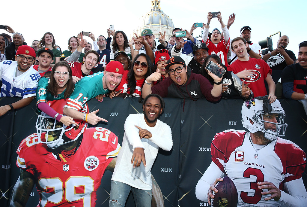 . Kendrick Lamar poses with NFL fans at the fifth annual NFL Honors at the Bill Graham Civic Auditorium on Saturday, Feb. 6, 2016, in San Francisco. (Photo by John Salangsang/Invision for NFL/AP Images)