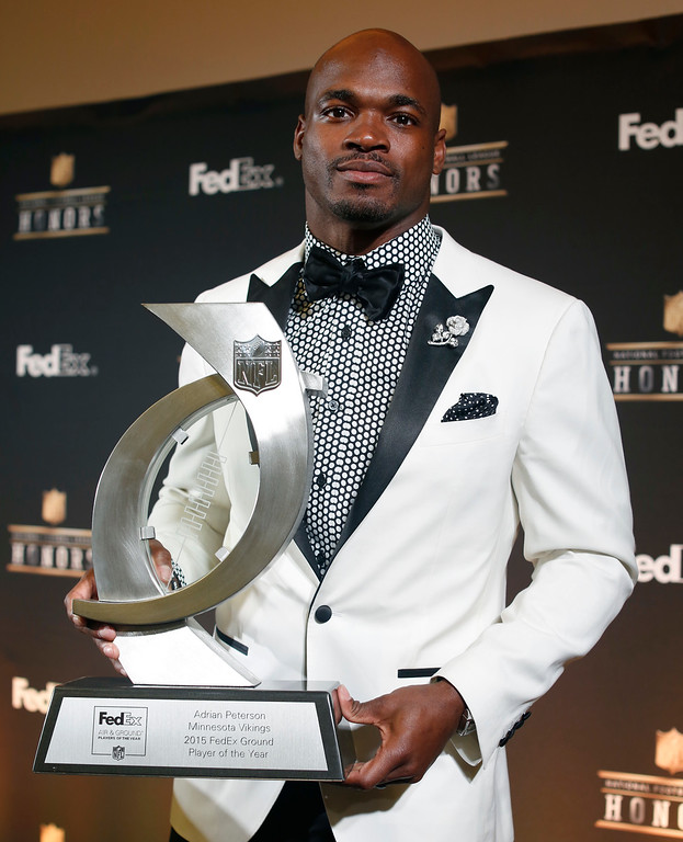 . Adrian Peterson of the Minnesota Vikings poses in the press room with the Fedex Air and Ground players of the year award at the fifth annual NFL Honors at the Bill Graham Civic Auditorium on Saturday, Feb. 6, 2016, in San Francisco. (Photo by Alison Yin/Invision for NFL/AP Images)