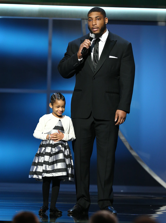 . Devon Still of the Houston Texans, right, and Leah Still present the AP comeback player of the year award at the 5th annual NFL Honors at the Bill Graham Civic Auditorium on Saturday, Feb. 6, 2016, in San Francisco. (Photo by John Salangsang/Invision for NFL/AP Images)