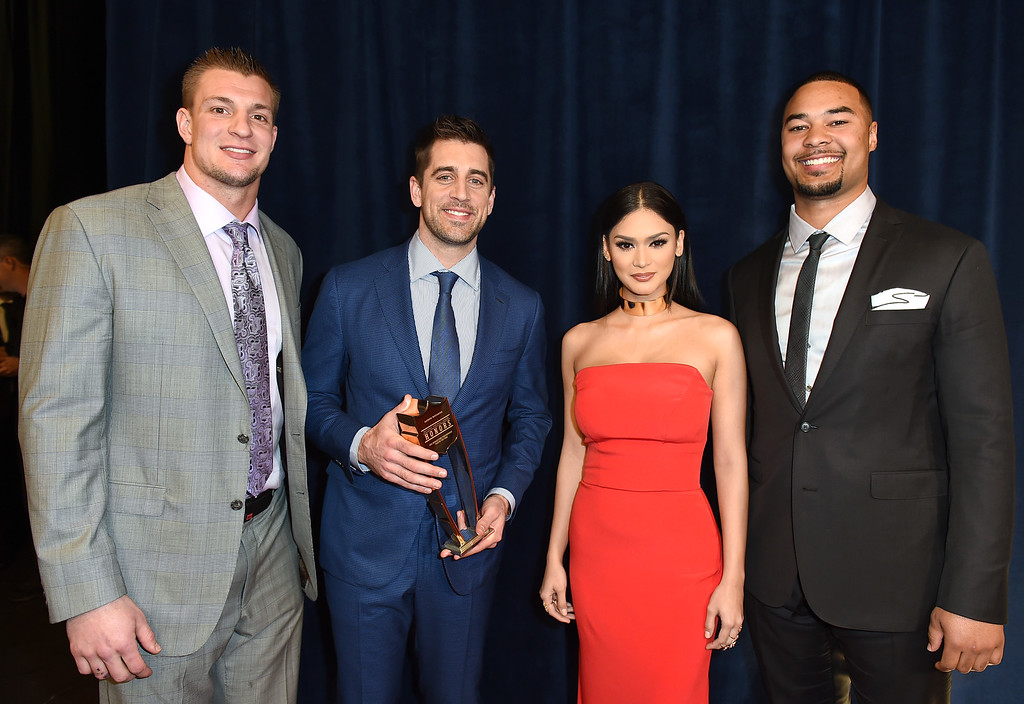 . New England Patriots\' Rob Gronkowski, Green Bay Packers\' Aaron Rodgers, Miss Universe Pia Wurtzbach, and Green Bay Packers\' Richard Rodgers pose backstage at the 5th annual NFL Honors at the Bill Graham Civic Auditorium on Saturday, Feb. 6, 2016, in San Francisco. (Photo by Jordan Strauss/Invision for NFL/AP Images)