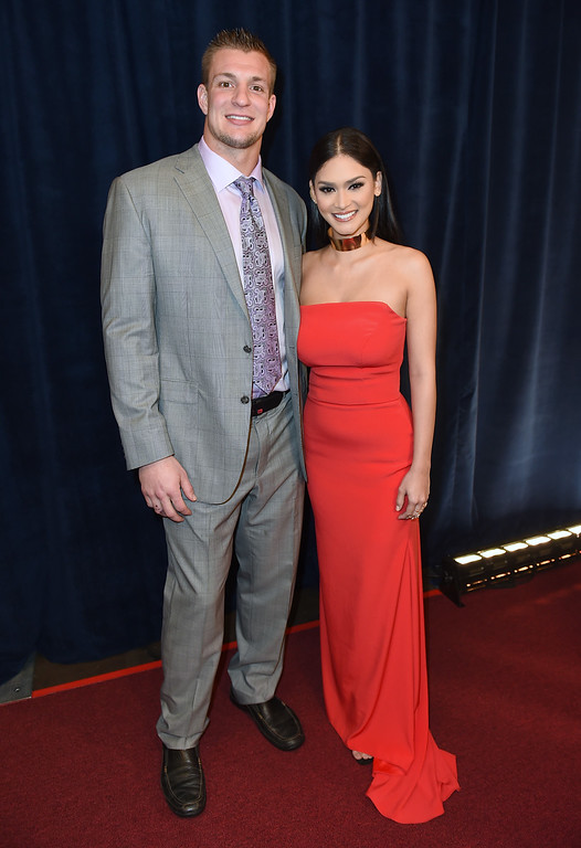 . New England Patriots\' Rob Gronkowski, left, and Pia Wurtzbach attend the fifth annual NFL Honors at the Bill Graham Civic Auditorium on Saturday, Feb. 6, 2016, in San Francisco. (Photo by Jordan Strauss/Invision for NFL/AP Images)