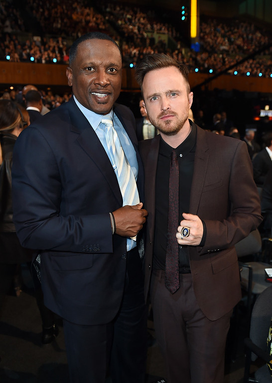 . Former NFL player Tim Brown, left, and Aaron Paul pose in the audience at the fifth annual NFL Honors at the Bill Graham Civic Auditorium on Saturday, Feb. 6, 2016, in San Francisco. (Photo by Jordan Strauss/Invision for NFL/AP Images)