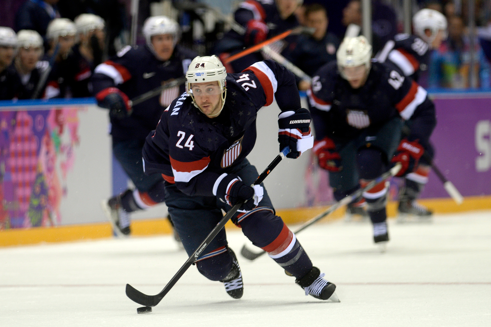 . Ryan Callahan (24) of the U.S.A. controls the puck against Russia during the first period of men\'s hockey action at Bolshoy arena. Sochi 2014 Winter Olympics on Saturday, February 15, 2014. (Photo by AAron Ontiveroz/The Denver Post)